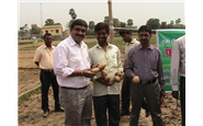 Nitishkumar (farmer), world record holder for potoato production with govt. official and Rajesh Uamtt, COO, GLS